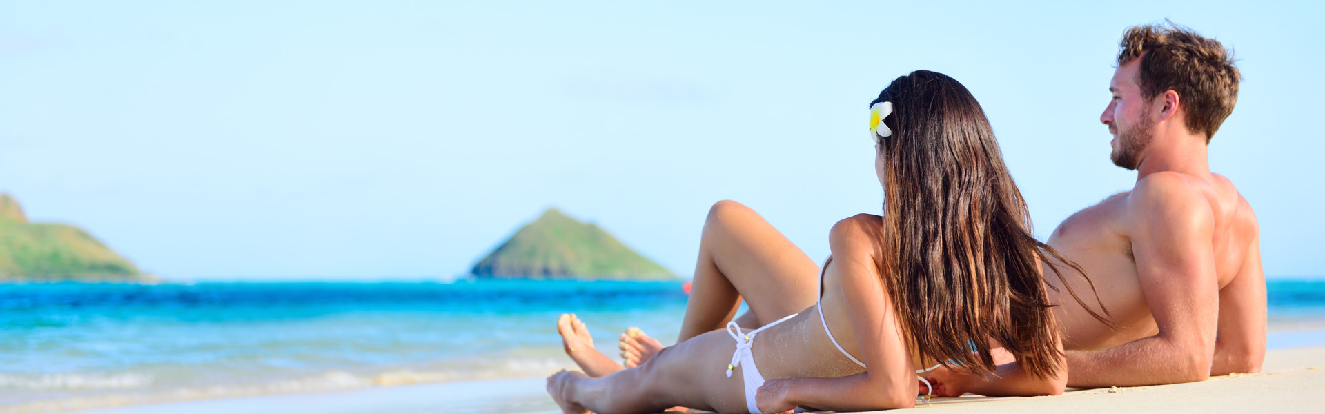 bigstock-Beach-sun-tan-couple-relaxing-82215002_1920x600